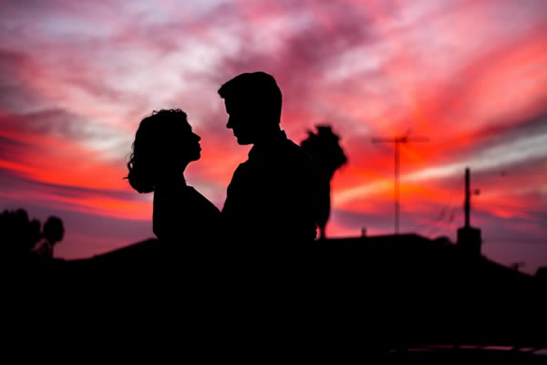 Couple embracing in a pink sunset