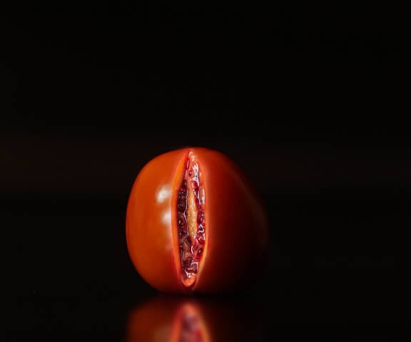 Red Tomato sliced open to look like a vulva